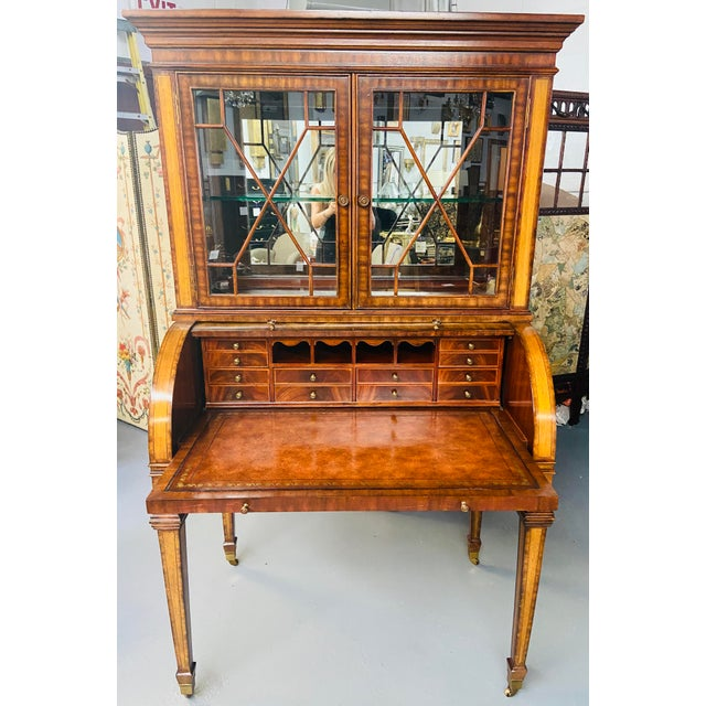 This stunning Regency style Maitland Smith flame mahogany secretary desk has two parts. The upper part is a two sectional...
