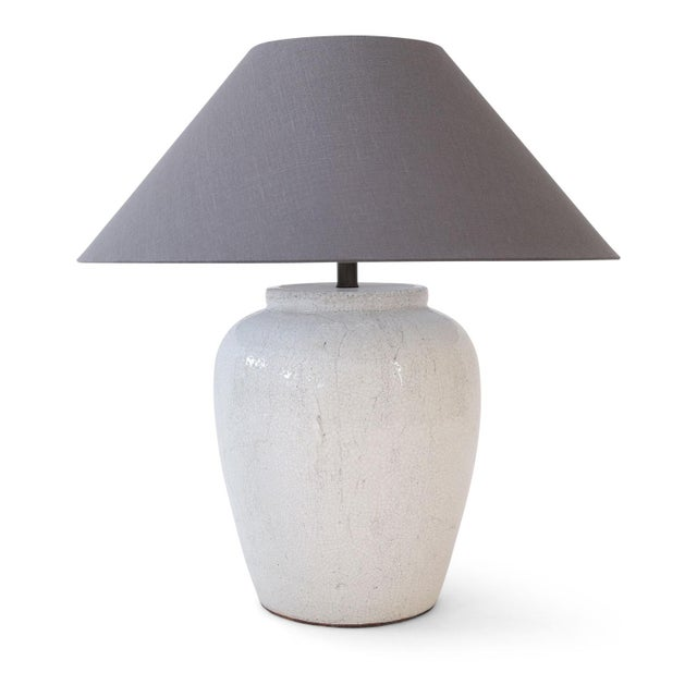 Two custom table lamps in crackle glaze finish and robust shape. Newly-wired for use within the USA. Measurements include...