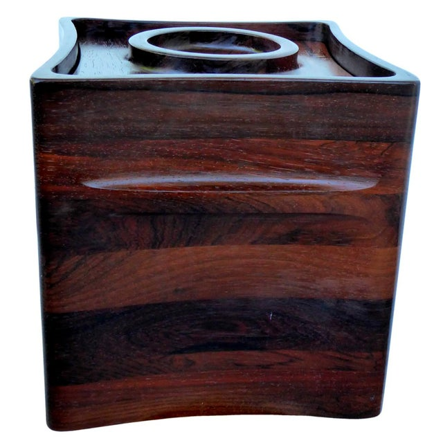 An exceptionally simple and elegant rosewood ice bucket by Jens Harald Quistgaard for Dansk. From the rare woods...