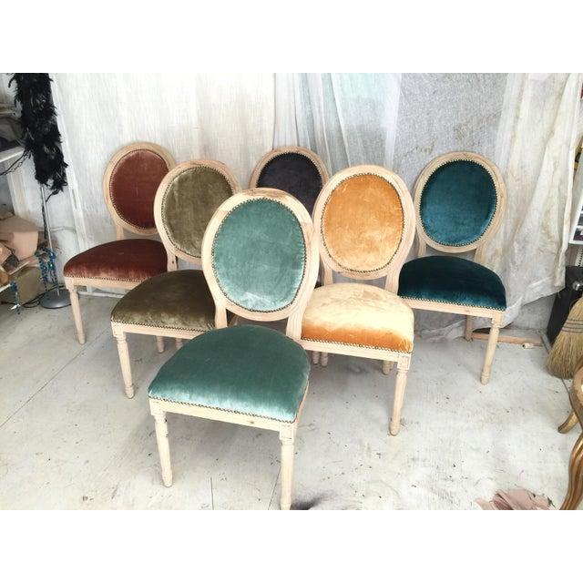 Set of 6 animal hide french dining chairs upholstered on outside back. Silk velvet upholstery on front in hazelnut, aqua,...