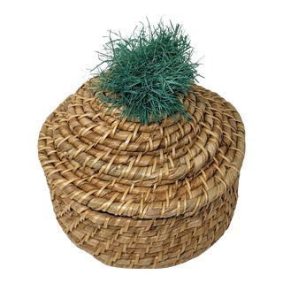 Boho Natural Tan and Turquoise Teal Green Natural Raffia Woven Covered Basket With Pom-Pom Decorative Accent For Sale