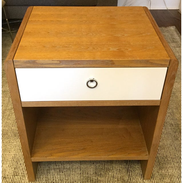 Add flair to your bedroom with this nightstand with an Art Deco silhouette in a limed oak finish. Its modern scale and...