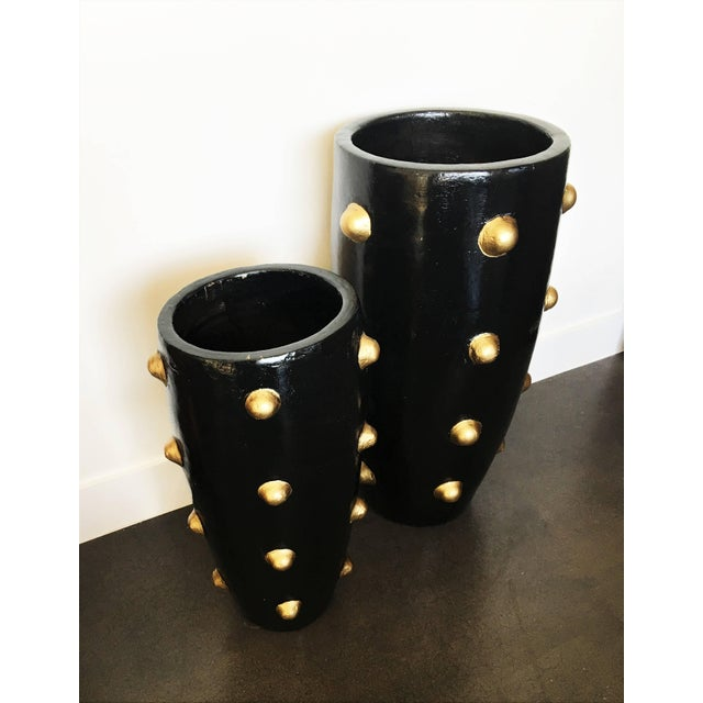 Pair one-of-a-kind ball pattern design sculpture planters. High fired glazed stoneware. Painted black and gold. These are...