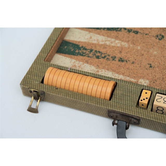 Vintage backgammon set with Bakelite game pieces and handle, cork game board, and fabric covered carrying case. Well...