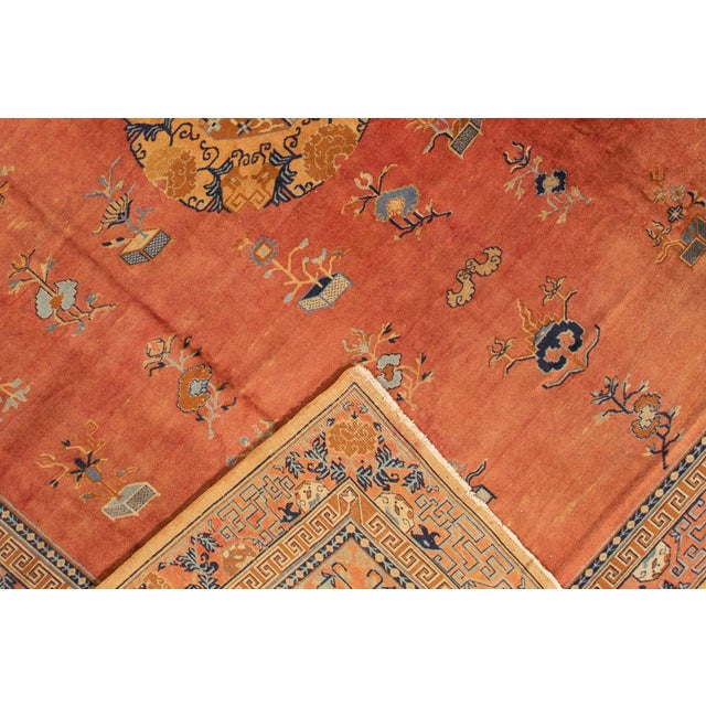 A hand-knotted antique Indo Chinese rug with a medallion Peking design. This piece has great detailing and colors. It...