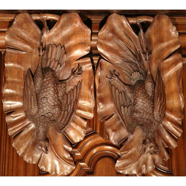 This pair of antique trophy carvings were created in France, circa 1900. The walnut pieces show two hunted, wooden...