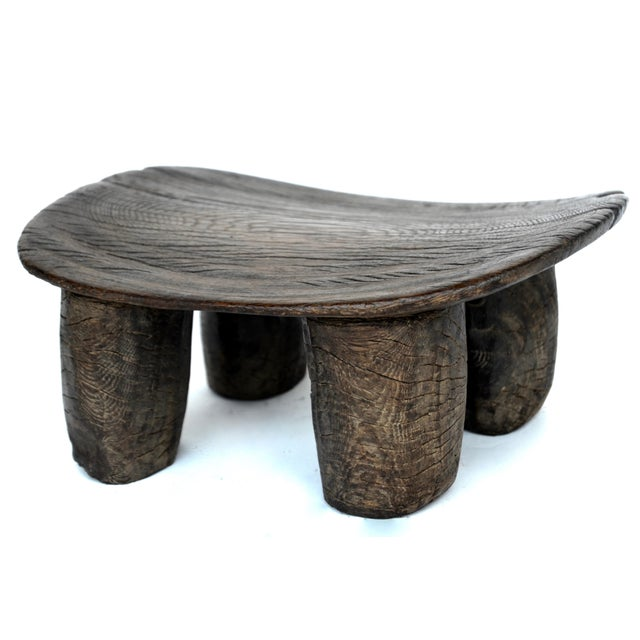 Authentic old wood Lobi stool from Burkina Faso with a simple modern form carved from a single piece of wood with a...