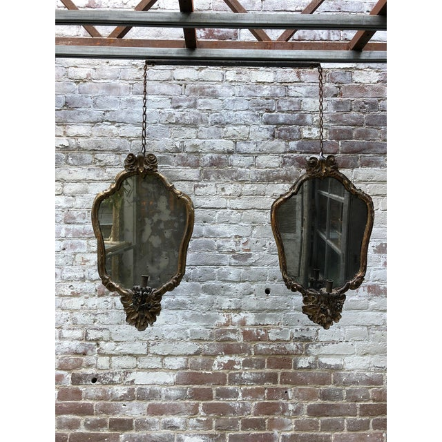 A beautiful pair of Italian girandoles with their original candle-arms. Provenance Venice . Beginning of the 18th Century...