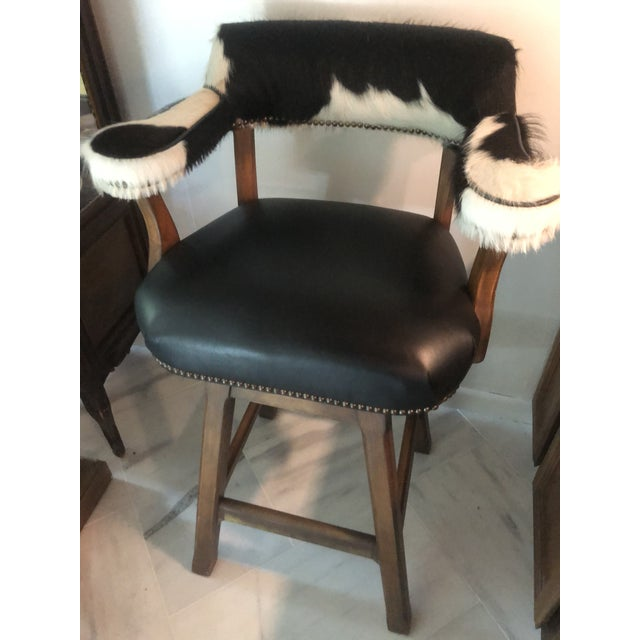 Horchow 4 Barstools available, price per piece Black leather with Cowhide armrests Captain chair model Swivel Good condition