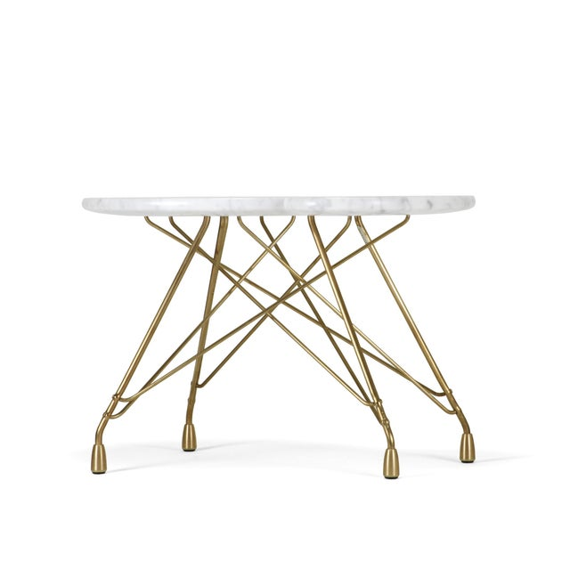 This distinctively sculpted Carrara marble table sits stylishly upon a forged solid bronze base. The marble top has a soft...