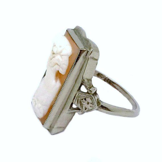 "Art Deco-Era 10K white gold ring bezel set with a rectangular hand-carved shell cameo, circa 1920. It measures .76"" long..."