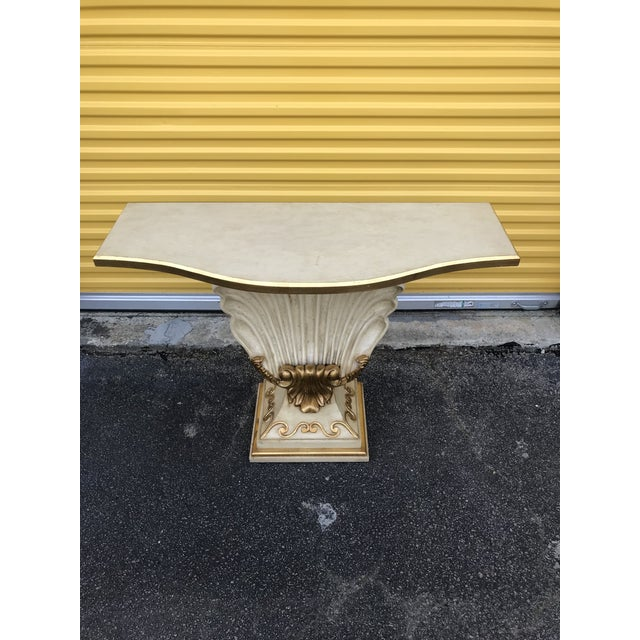 Hollywood Regency shell console table. Minor wear shown in photos on gold edges. Overall, excellent vintage condition....