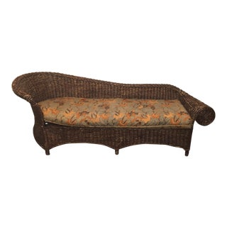 Vintage Dark Wicker Chaise Lounge With Printed Batik Cushion For Sale