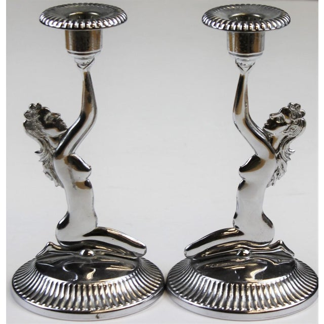 """Pair of chrome 'Naked Lady' candlesticks . Dimensions: 7""""H x 3 3/4""""D"""
