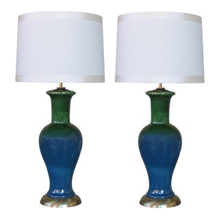 A shapely pair of American 1960's Frederick Cooper baluster-form emerald green and blue drip-glazed lamps
