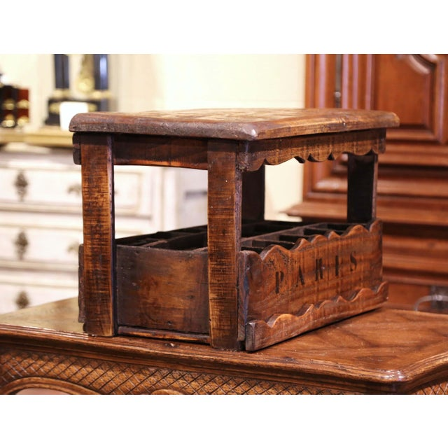 This interesting wooden wine or Champagne bottle holder was carved in France, circa 1920. The useful antique cabinet, made...