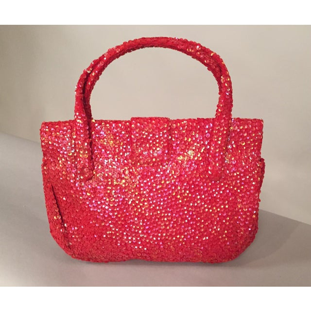 What a great idea, an evening bag large enough to hold everything that you need for a night out! This fabulous bag is...