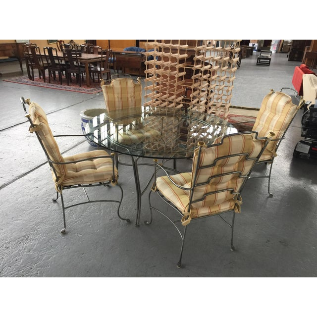 Contemporary table set in Excellent condition. Cushions and table in excellent clean condition (the cushions look like...
