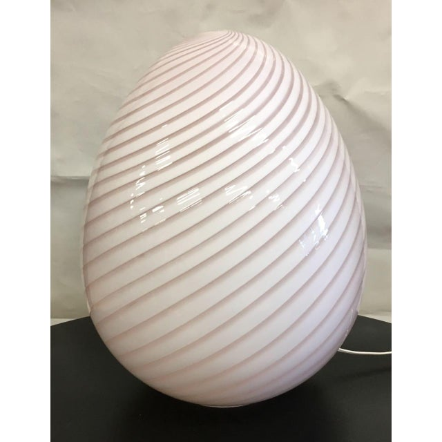 Vintage Murano egg lamp. One large vessel of white-on-white swirled Italian glass that creates an enchanting pink glow...