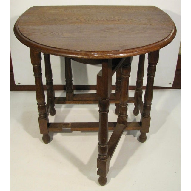 English gateleg drop-leaf table offers versatile use and convenience as a side table or opened for a small dining table