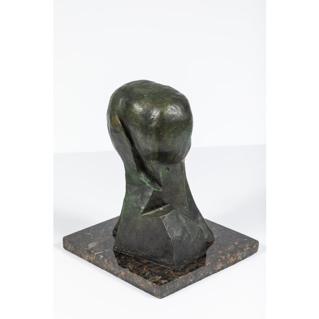 """Abstract bronze sculpture inscribed """"Picasso"""" and numbered 23/50. Mounted on marble base."""
