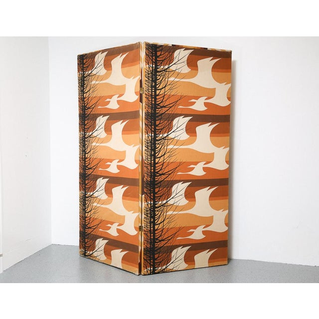 Groovy double sided 2-panel room divider. Fabric covered wooden panels. One side showing stylized flying geese, and on the...
