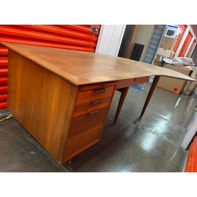 Beautiful mid century walnut executive desk with stunning walnut grain and dramatic boomerang shape. It was deigned by...