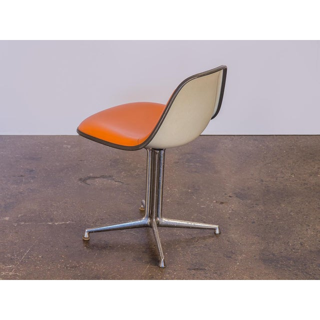 Orange vintage La Fonda Chair by Charles and Ray Eames for Herman Miller. Price is for a single chair. We have three...