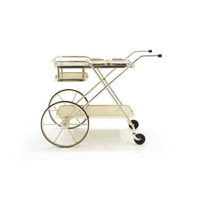 Striking Bar Trolley by Kaymet. All original wheels, casters and includes the original matching pair of serving trays....