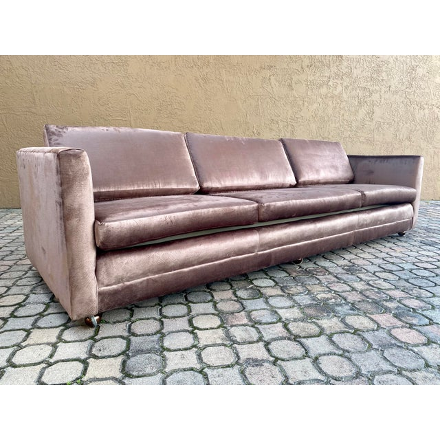 This is with out a doubt eye catching!! Newly restored 70's Selig Tuxedo sofa. Reupholstered in a beautiful gloosy brown...