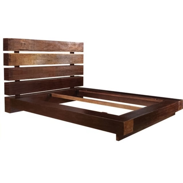 Used on in model apartment stagings only, this Bina Iggy Queen Platform Bed frame from Four Hands is handcrafted from...