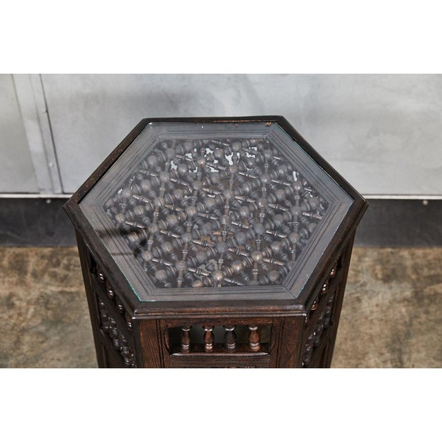 This interesting six sided tabouret table has delicate decorative elements throughout. The table has a glass top and nice...