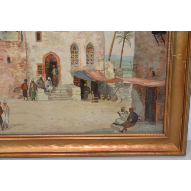 Late 19th to Early 20th Century Middle East Oil Painting A remarkable North African scene with camels, a mosque and desert...