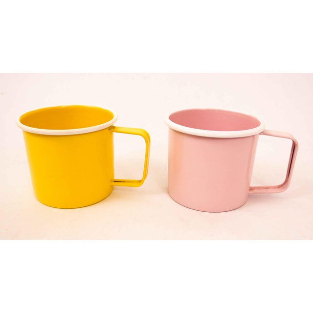 A gorgeous pair of enamelware mugs in pastel pink and soft yellow. Add a fresh pop of color to your morning routine. Depth...