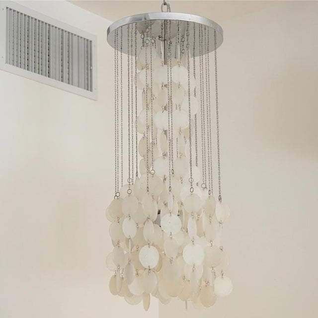 Mazzega Cascade Chandelier White glass disks suspended on nickel chains. Two available. Priced Individually.