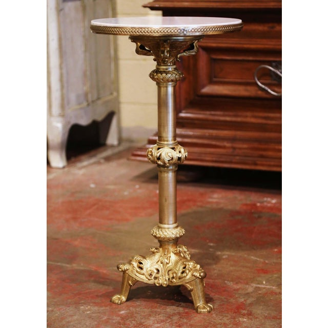 This elegant antique bronze and marble table was created in Paris, France, circa 1880. The pedestal stands on an intricate...