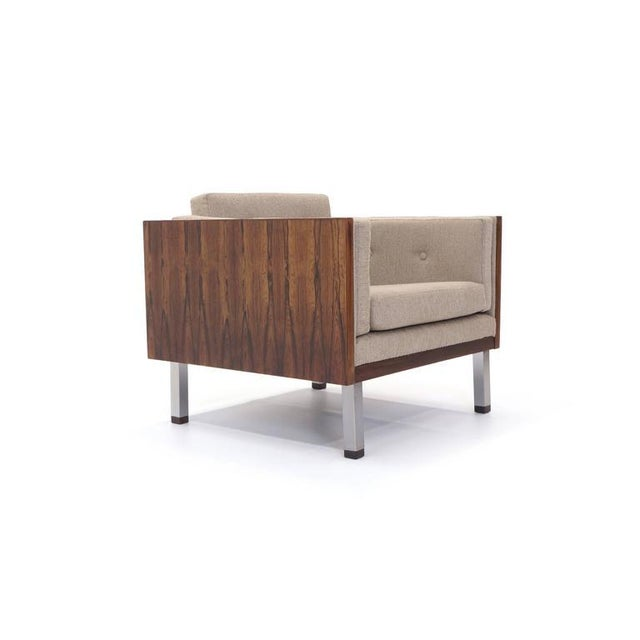Rosewood case lounge chair designed by Jydsk Møbelværk. Brushed steel legs with rosewood feet. Also see our listing for...