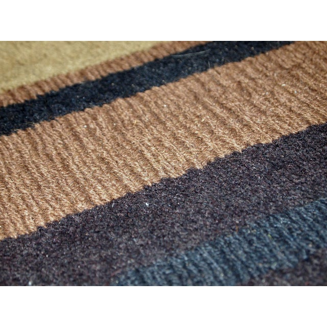 Vintage handmade Indian striped rug in blue, purple and different shades of brown. Each line of the rug made in different...