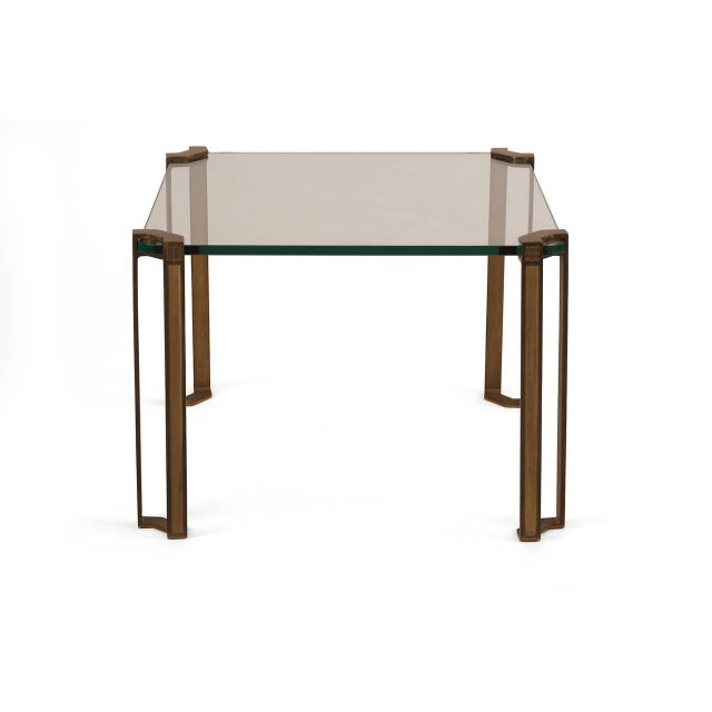 Stunning bronze and glass side or cocktail table by Peter Ghyczy, circa early 1970s. This example handsomely wraps around...