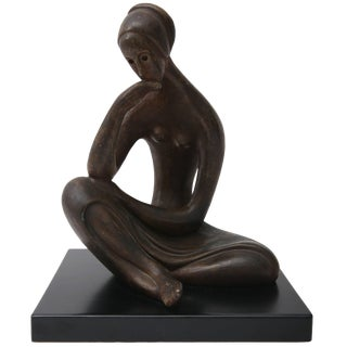 Sculpture of a Seated Female in Bronze Coloration For Sale