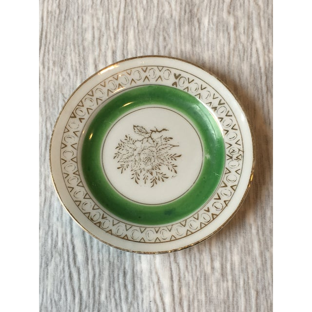 These Japanese porcelain mini plates are hand-painted, each showcasing a blossom branch of gilt gold. The gold continues...