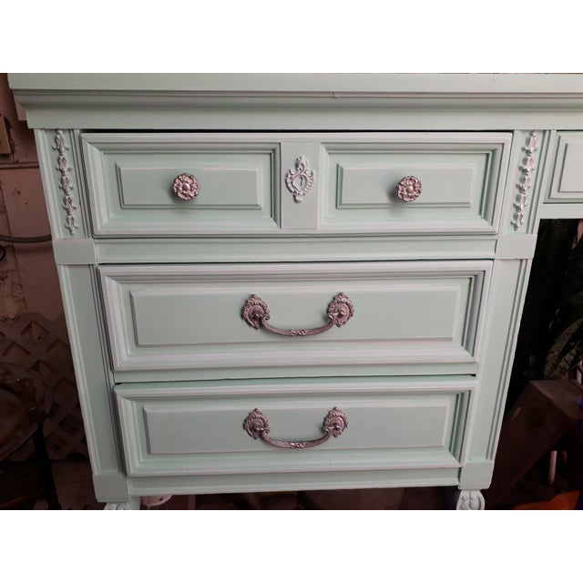 """Lovely vintage wood desk finished in """"sea glass"""" chalk paint. Handles finished with a touch of silver leaf wax. Veneer on..."""