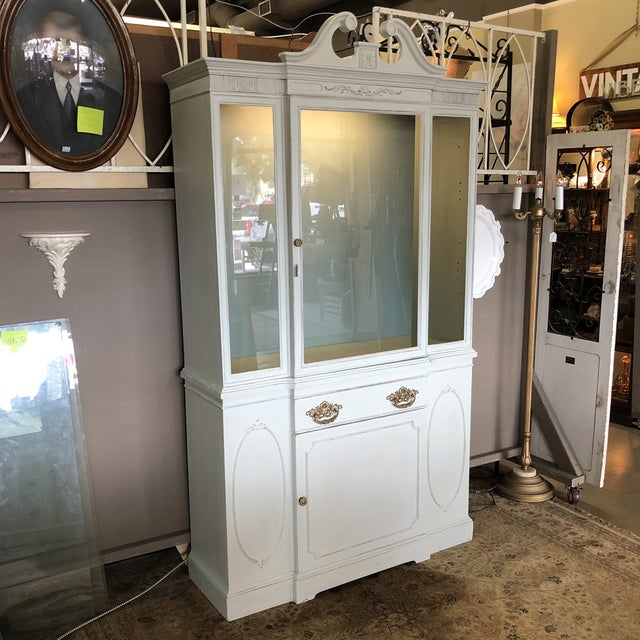 One piece china cabinet with new led light. Two glass shelves and one wood shelf in the bottom portion. Beautiful brass...
