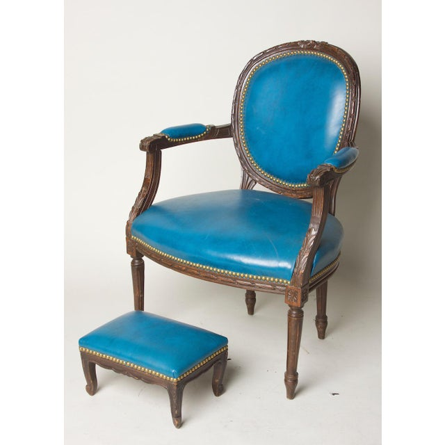 Belgian fauteuil or open arm chair and matching footstool original blue leather and what a blue it is. Cerulean is the...