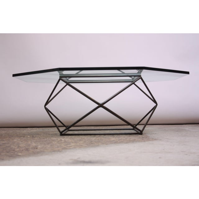 Early 1970s geometric coffee table by Milo Baughman for Directional. Bronze-finished base with original, octagonal glass...