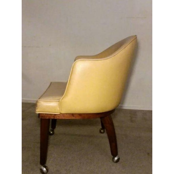 A gorgeous yellow tone vinyl Danish Modern Accent Chair on Brass Casters. Has great lines, original finish and a beautiful...