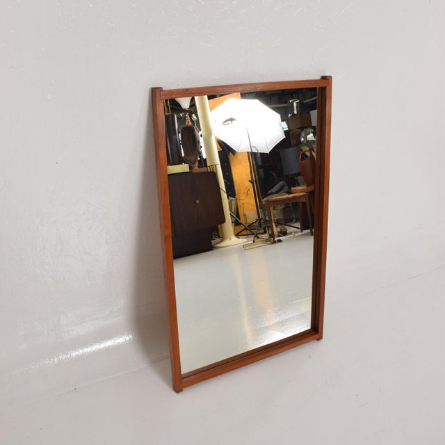 For your consideration, A vintage teak mirror. Solid teak wood frame with vintage mirror. No label present from the maker....