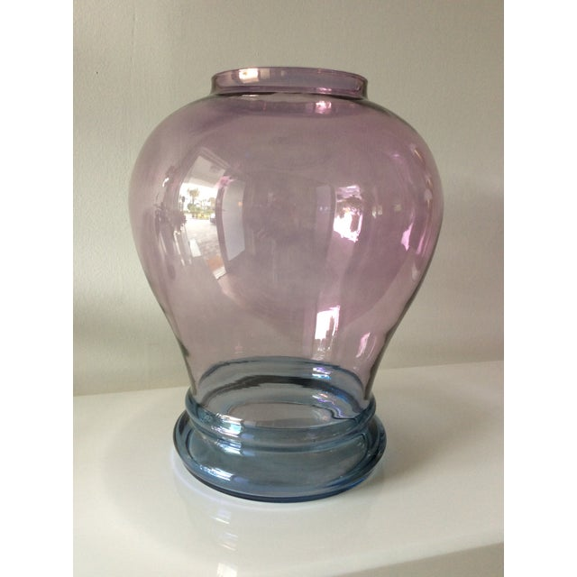 Transparent glass vase with a touch of luminescence. This vase has blue at base then becomes purple or lilac with darker...