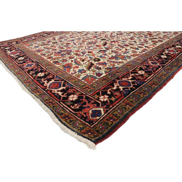 77338, antique Persian Heriz runner with Tudor Manor House style. This hand knotted wool antique Persian Heriz runner...