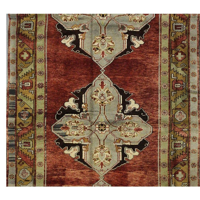 This beautiful vintage Turkish Oushak rug is hand-knotted, 100% wool, made in Turkey, Oushak region. It features a pattern...